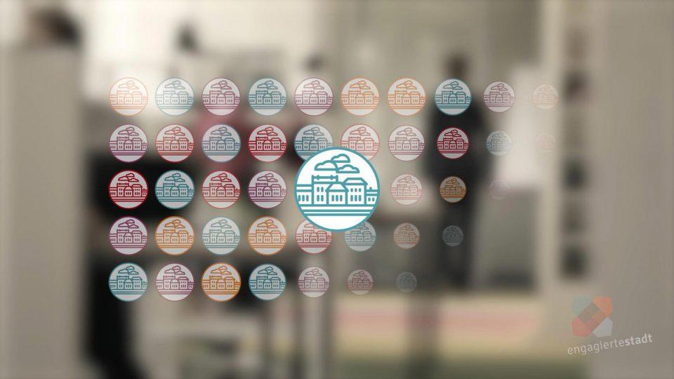 Eine 2D Grafik einer Stadt in verschiednen Farben als Visualisierung der Engagierten Stadt