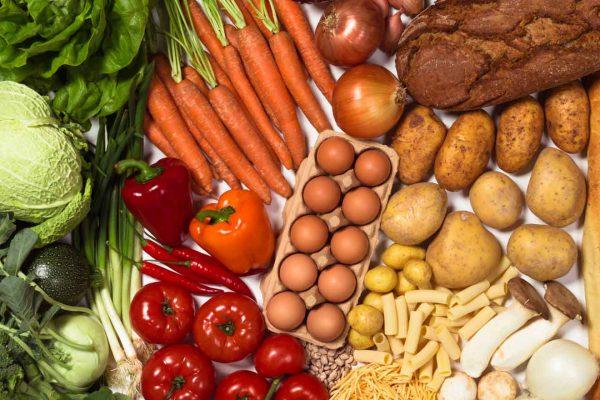 Ein Collage aus frischen Bio Gemüse als Firmenbotschaft des Catering Unternehmens Windmann